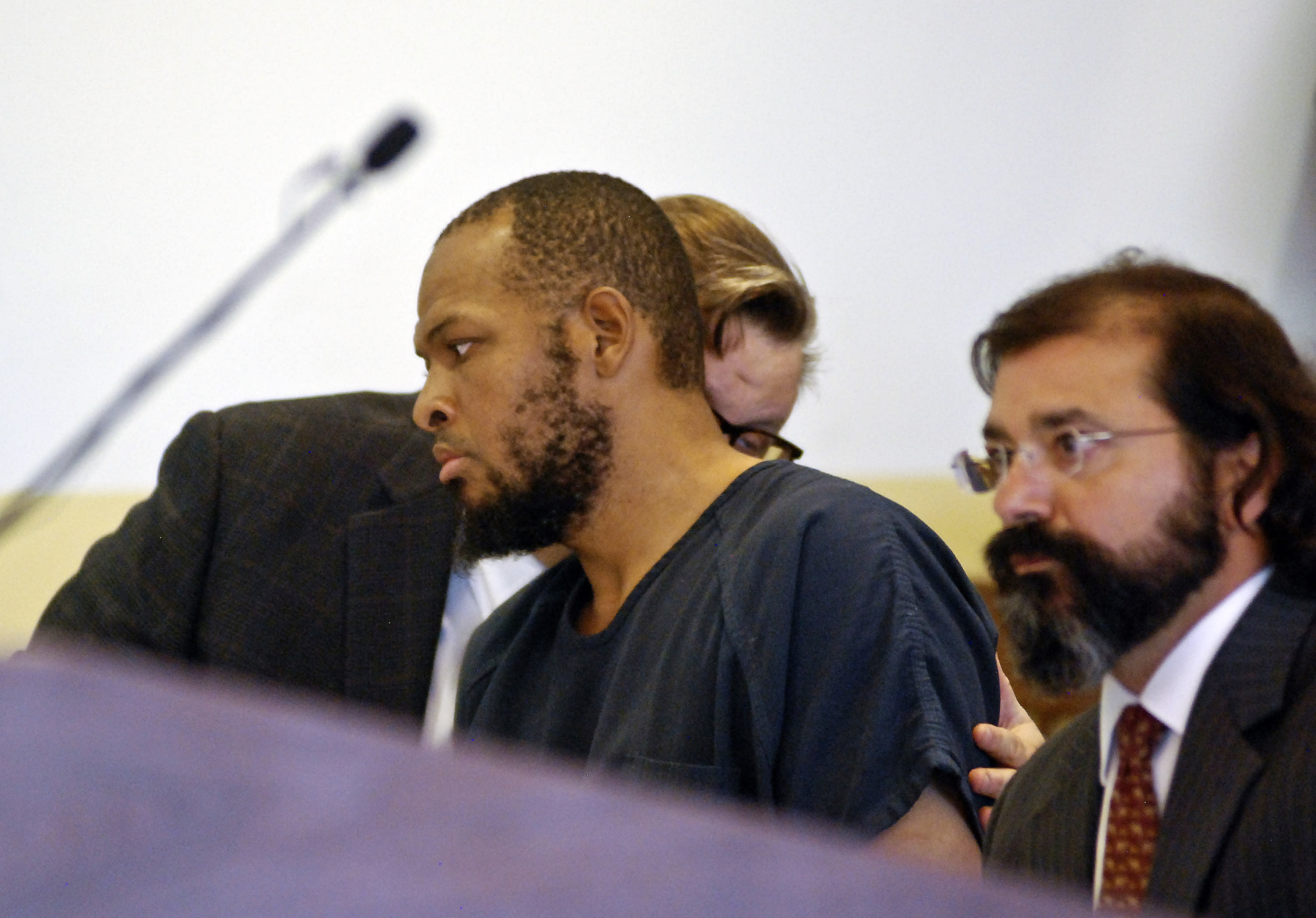 The Latest: Attorney says client in federal custody
