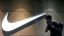 Stocks - Nike, Tesla, Jd.com Slide in Pre-market; Apple, Disney Gain