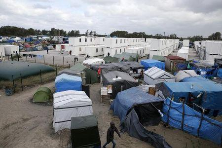 """A view shows makeshift shelters, tents and containers where migrants live in what is known as the """"Jungle"""", a sprawling camp in Calais, France, October 12, 2016. REUTERS/Pascal Rossignol"""