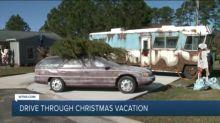 Lawyer's Garage Car Display Spreads Christmas Cheer