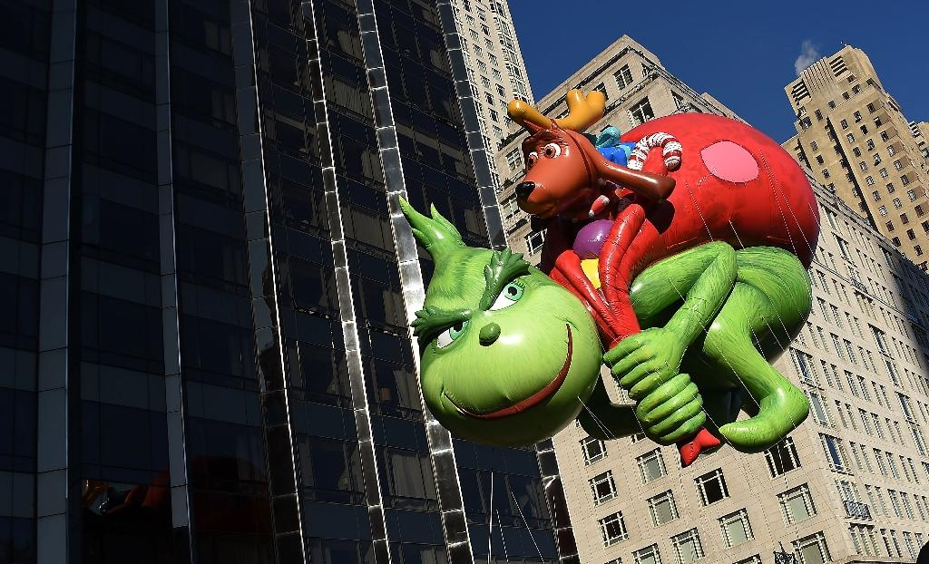 """The Dr. Seuss Grinch and Max balloon during the 91st Annual Macy's Thanksgiving Day Parade. Researchers say automated programs or """"Grinch bots"""" may be scooping up prized holiday gifts for resale at exorbitant markups (AFP Photo/Michael loccisano)"""