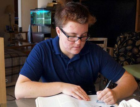 Nate Quinn, 17, works on a paper at his home in Sarasota, Florida, U.S., April 12, 2016. REUTERS/Letitia Stein