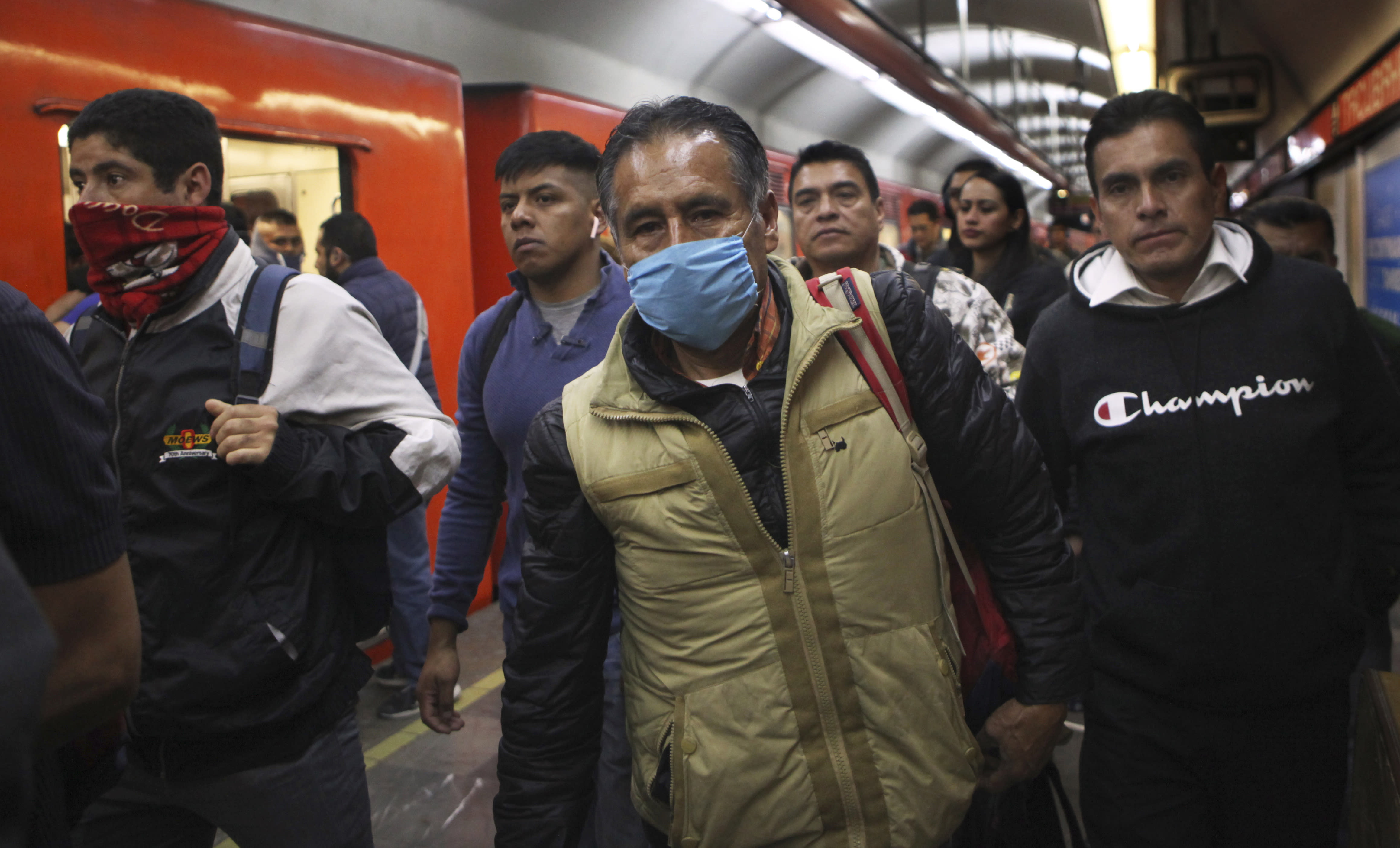 A commuter wears a protective mask as a precaution against the spread of the new coronavirus in the metro in Mexico City, Thursday, March 19, 2020. (AP Photo/Marco Ugarte)