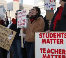The Latest: District says 58 percent of Denver teachers out