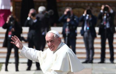 Pope Francis waves as he leaves at the end of a Holy Mass to mark the feast of Divine Mercy at the Vatican