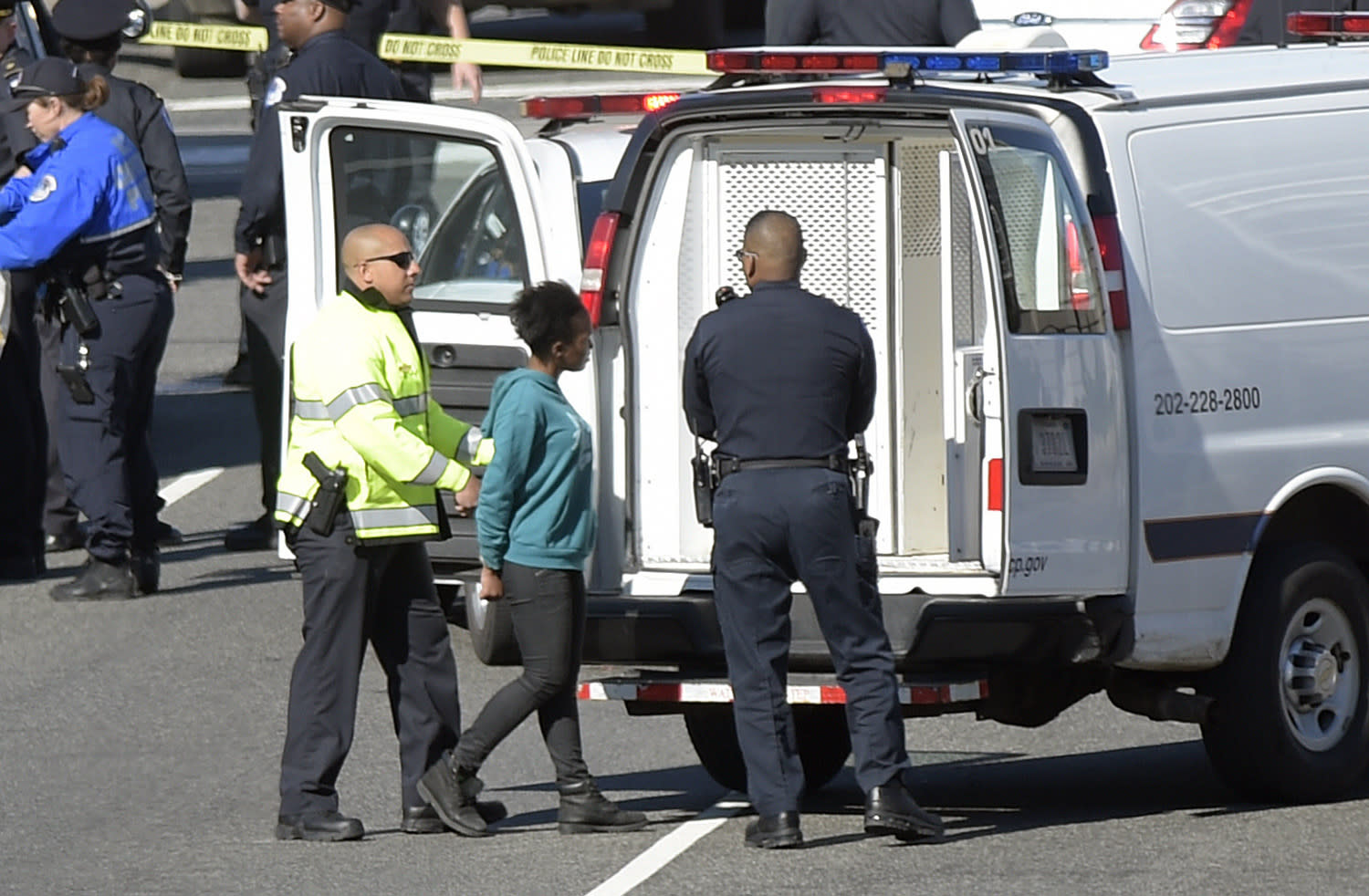 <p>A woman, center, is taken into custody on Capitol Hill in Washington, Wednesday, March 29, 2017. Police say a driver struck a U.S. Capitol Police cruiser near the U.S. Capitol and was taken into custody. (AP Photo/Susan Walsh) </p>