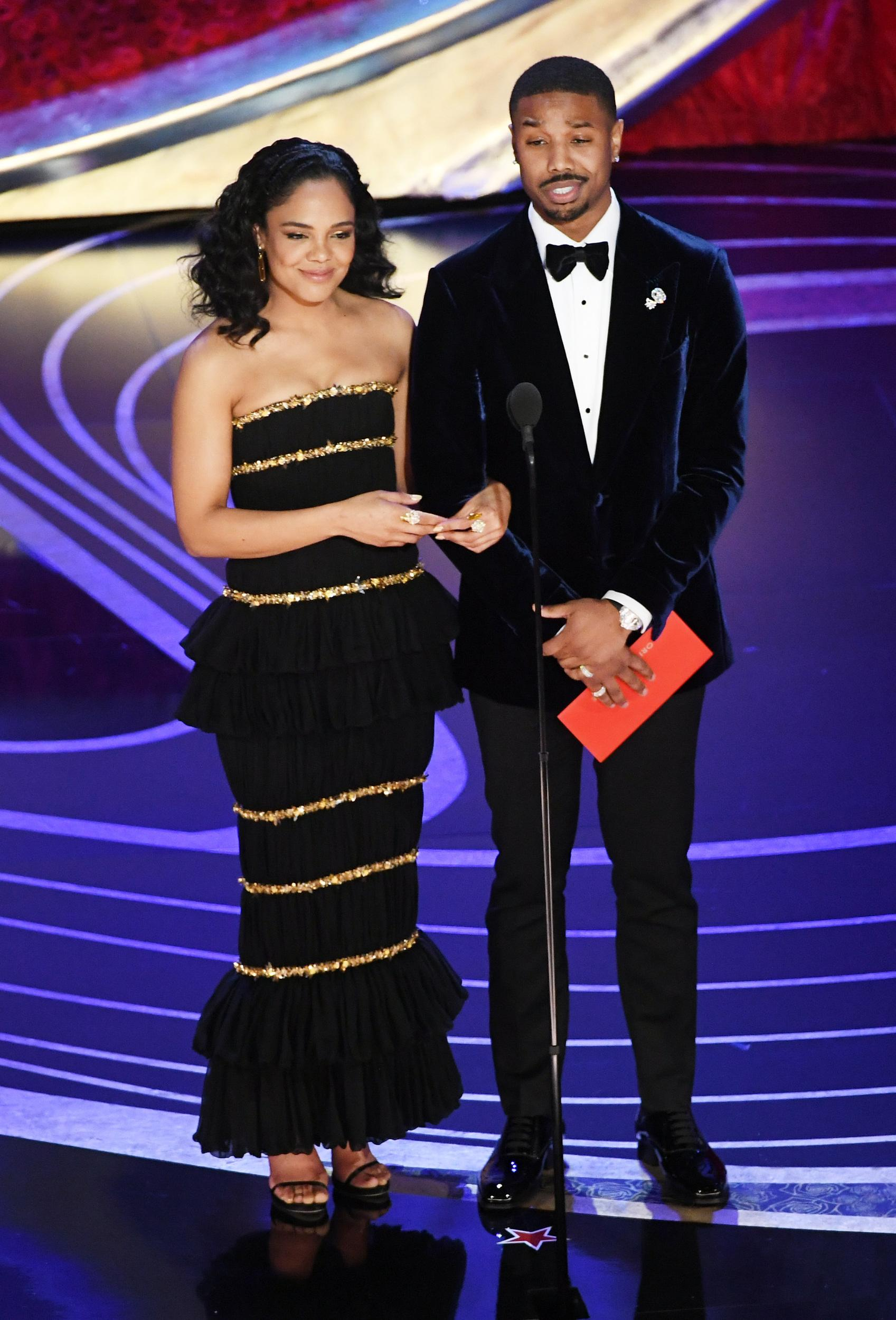 HOLLYWOOD, CALIFORNIA - FEBRUARY 24: (L-R) Tessa Thompson and Michael B. Jordan speak onstage during the 91st Annual Academy Awards at Dolby Theatre on February 24, 2019 in Hollywood, California. (Photo by Kevin Winter/Getty Images)