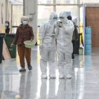 Virus spreads in S Korean city as thousands are screened