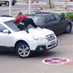 Watch fearless Milwaukee woman cling to car windshield as carjacker speeds away