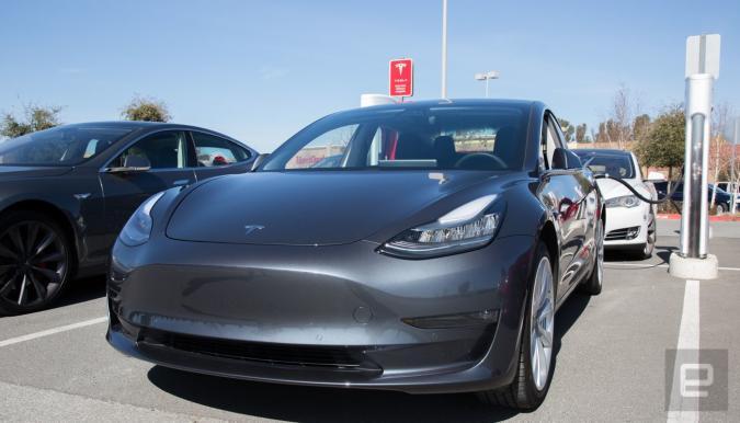 Tesla Model 3 at a Supercharger station