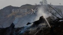 Brush fire prompts evacuation of landmark Griffith Observatory in Los Angeles