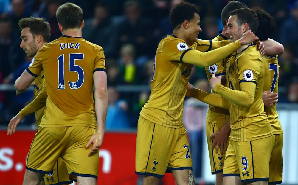 Tottenham's players celebrate Son's goal at Swansea - AFP