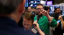 U.S. yields rise in auctions as stocks sink; dollar recovers