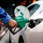 Oil ends higher after volatile trade on dollar, Libya output