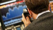 Sterling slide boosts FTSE 100 after resignations hit UK government