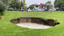 Giant sinkhole appears after heavy rain and hail smash Melbourne