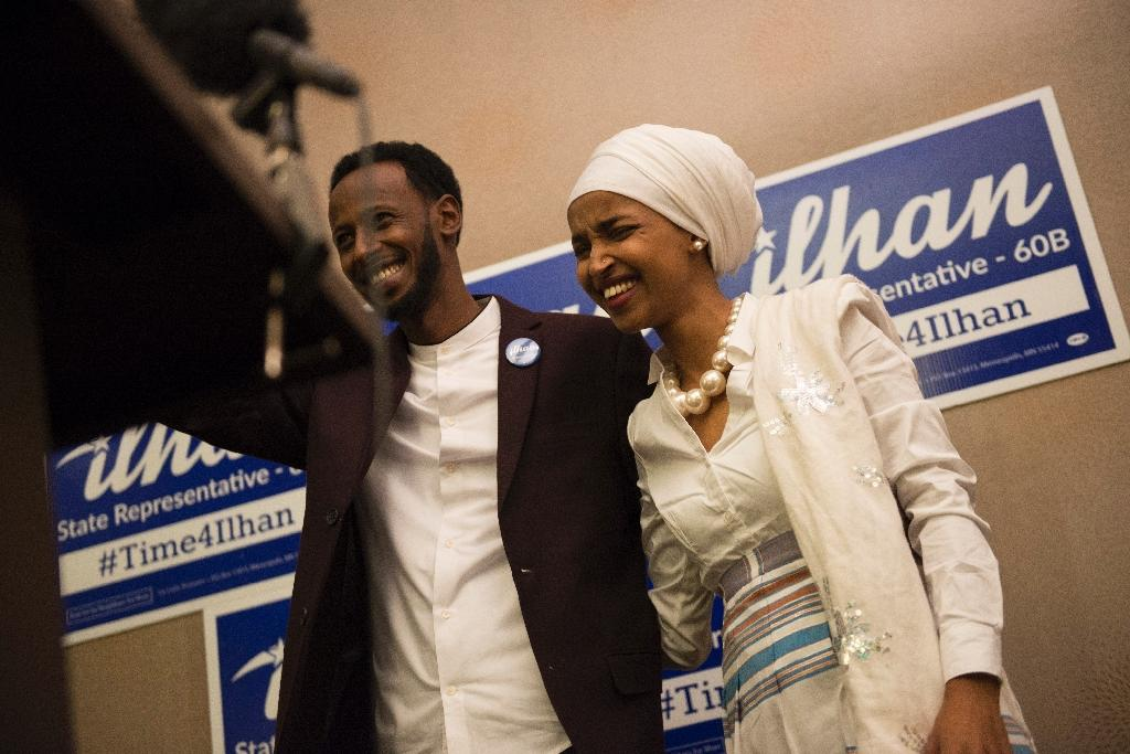 Ilhan Omar's (R) victory as a newly elected candidate for state representative for Minnesota's District 60B is notable in a campaign season that saw Republican Donald Trump disparage Muslim immigrants and refugees before winning the presidency (AFP Photo/Stephen Maturen)