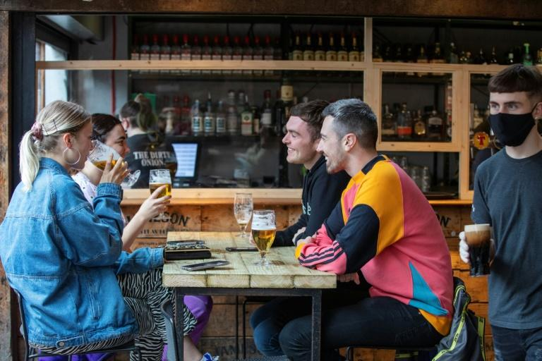 Pubs in Northern Ireland began serving again on Friday while English pubs reopened on what is being dubbed 'Super Saturday' (AFP Photo/Paul Faith)