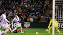 Griezmann shoots Atletico level with Barcelona