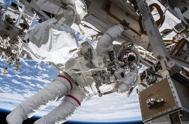 Watch astronauts install commercial spacecraft adapter on the ISS