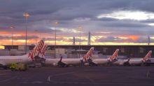 Virgin Australia to merge units, cut jobs as it swings to FY loss