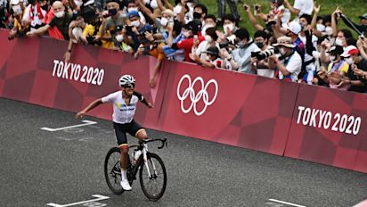 Fans ignore rules, hit course to cheer on cyclists