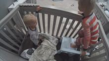 Brother helps 1-year-old escape from crib: 'You can do it. Finn, jump to me!'
