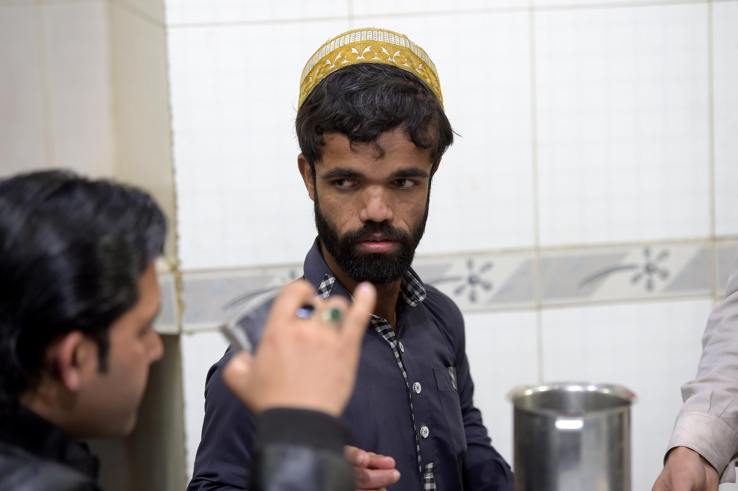 In this picture taken on February 22, 2019, Rozi Khan (R), a 25-year-old Pakistani waiter who resembles US actor Peter Dinklage, works at Dilbar Hotel in Rawalpindi. - Rozi Khan had never heard of the Game of Thrones -- or its hugely popular character Tyrion Lannister -- until his striking resemblance to the dwarf anti-hero got heads turning at home. (Photo by AAMIR QURESHI / AFP) / To go with PAKISTAN-LIFESTYLE-TELEVISION-ENTERTAINMENT        (Photo credit should read AAMIR QURESHI/AFP/Getty Images)