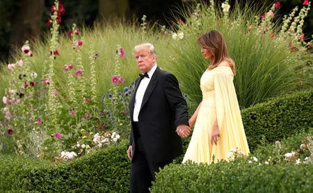 U.S. President Donald Trump and the first lady Melania Trump leave the U.S. ambassador's residence, Winfield House, in London, July 12, 2018. REUTERS/Kevin Lamarque