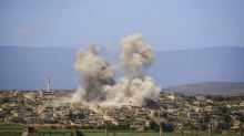 Russia says Syrian government forces halt fire in Idlib