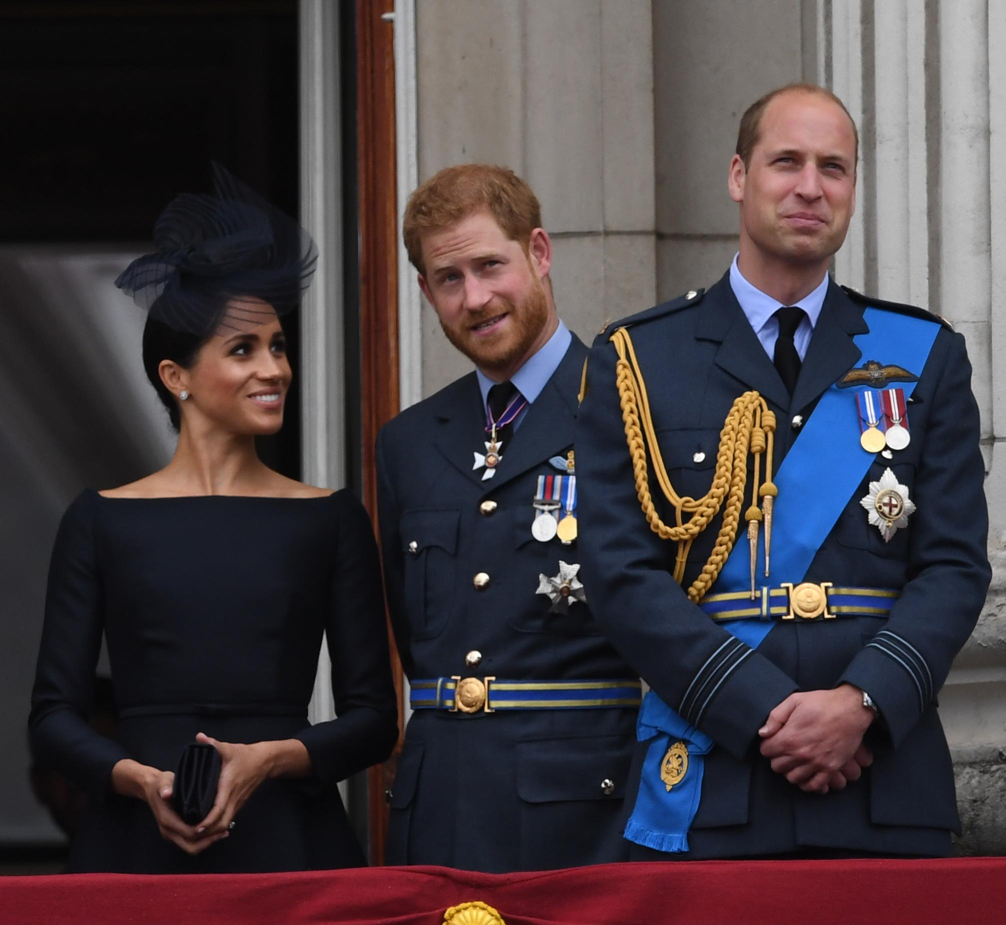 (left to right) The Prince of Wales, Duke of York, Duchess of Cornwall, Queen Elizabeth II, Duchess of Sussex, Duke of Sussex and Duke of Cambridge on the balcony at Buckingham Palace where they watched a Royal Air Force flypast over central London to mark the centenary of the Royal Air Force.