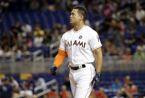 Giancarlo Stanton has never experienced a winning season with the Marlins. (AP Photo)