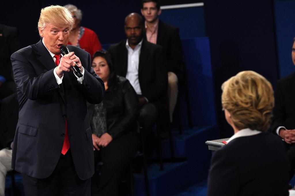 Republican Presidential nominee Donald Trump speaks during a town hall debate on October 9, 2016 (AFP Photo/Saul Loeb)