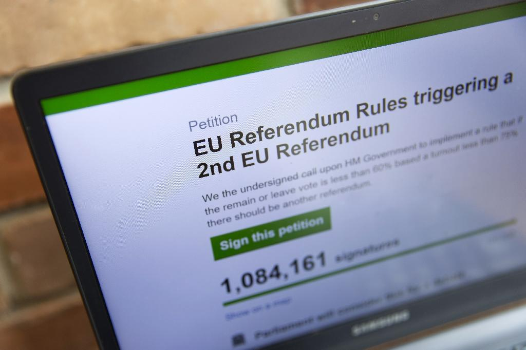 A laptop screen displays a parliamentary petition on the website of the British government, calling for a second referendum on the UK's EU membership (AFP Photo/Justin Tallis)