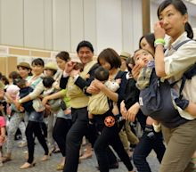Japanese politician barred from bringing baby to council session
