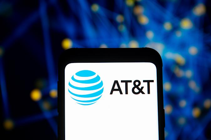 POLAND - 2020/03/23: In this photo illustration an At&T logo seen displayed on a smartphone. (Photo Illustration by Mateusz Slodkowski/SOPA Images/LightRocket via Getty Images)