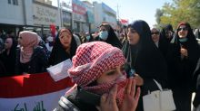 Iraqi security forces kill protester, rockets hit U.S. embassy
