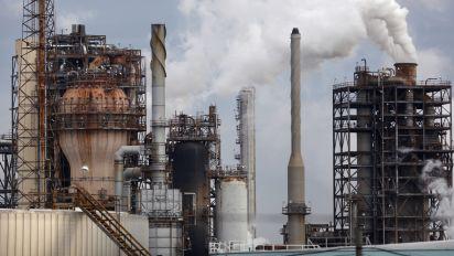 Oil holds near $51 amid OPEC cuts