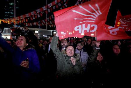 Supporters of CHP Party follow the election results outside the party headquarters in Ankara