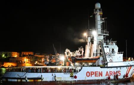 Migrants disembark Open Arms rescue ship on Italian island of Lampedusa