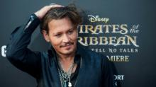 US filmgoers keep eye on Sparrow, as 'Pirates' opens strong