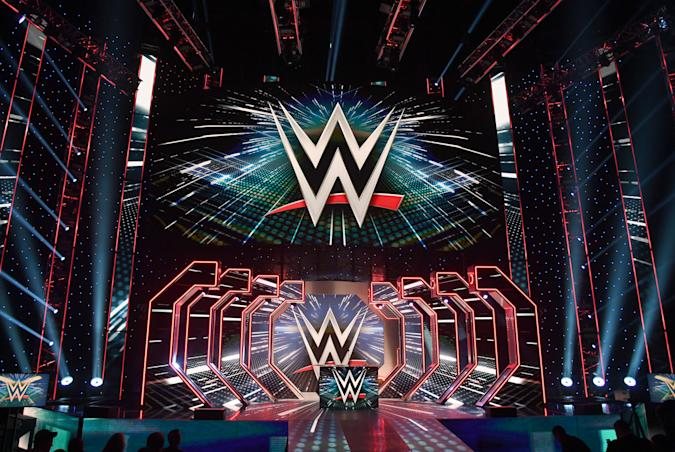 LAS VEGAS, NEVADA - OCTOBER 11:  WWE logos are shown on screens before a WWE news conference at T-Mobile Arena on October 11, 2019 in Las Vegas, Nevada. It was announced that WWE wrestler Braun Strowman will face heavyweight boxer Tyson Fury and WWE champion Brock Lesnar will take on former UFC heavyweight champion Cain Velasquez at the WWE's Crown Jewel event at Fahd International Stadium in Riyadh, Saudi Arabia on October 31.  (Photo by Ethan Miller/Getty Images)