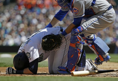 Mets catcher Travis d'Arnaud rushes to aid Mitch Haniger after Haniger was hit by a pitch thrown by Jacob deGrom. (AP)