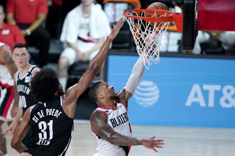 NBA roundup: Lillard, Blazers claim final play-in berth