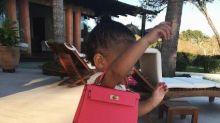 Kylie Jenner's 1-year-old daughter, Stormi Webster, won't let go of her $17,000 handbag