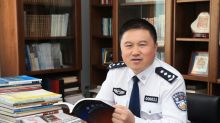 China sacks senior police officer over 'absurd' Peace Mantra book