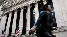 Stocks close higher on positive earnings, though trade concerns linger