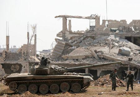 FILE PHOTO: Soldiers loyal to Syria's President Bashar al-Assad forces are deployed at al-Qadam area near Yarmouk Palestinian camp in Damascus
