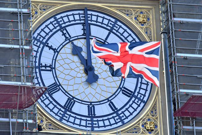 The clock face of Elizabeth Tower, known after the bell Big Ben, shows the hands at eleven o'clock as a Union Flag flies in front of it in London on January 28, 2020. - Britain will formally leave the European Union at 11pm GMT on January 31, 2020. (Photo by Justin TALLIS / AFP) (Photo by JUSTIN TALLIS/AFP via Getty Images)