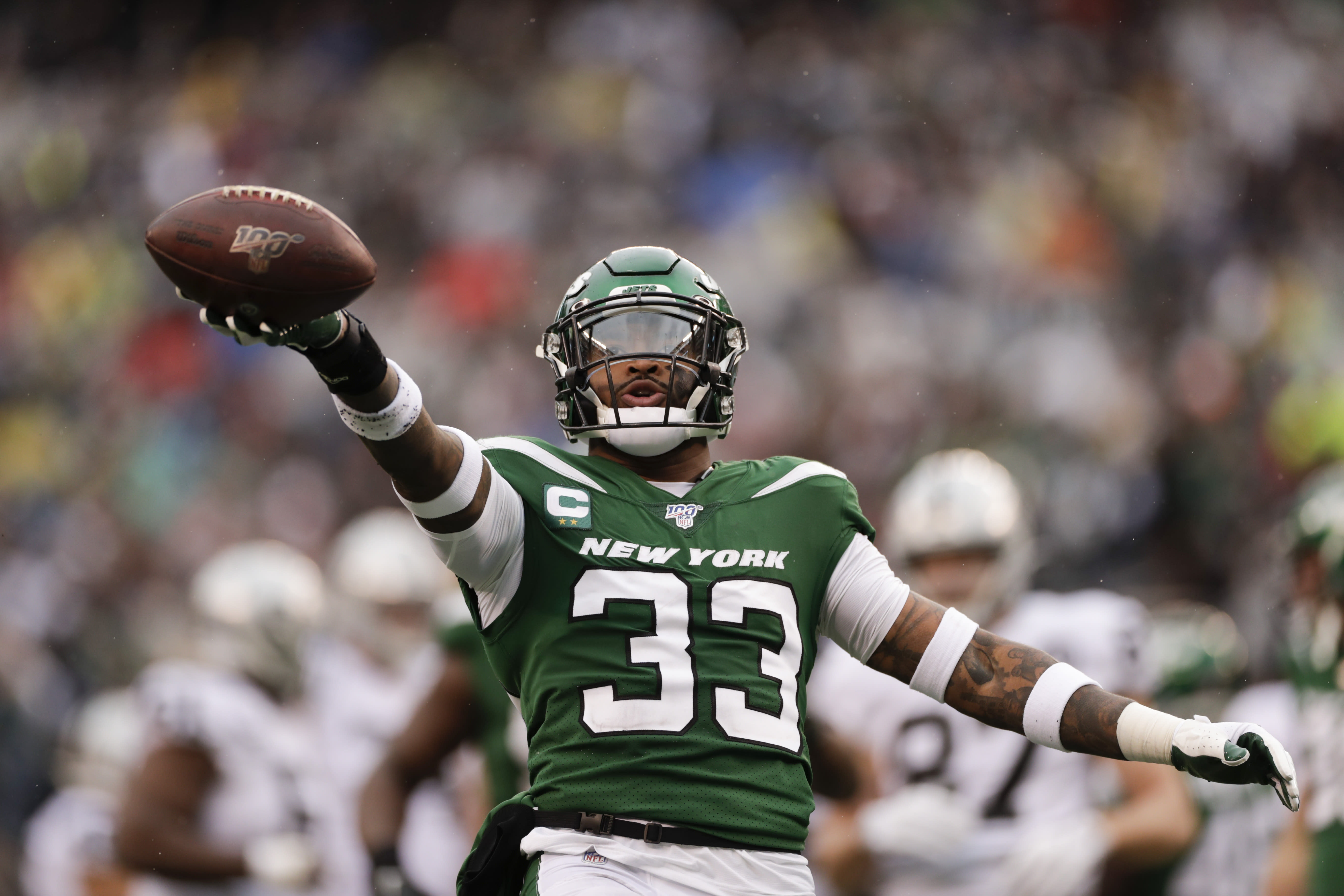 FILE - In this Nov. 24, 2019, file photo, New York Jets strong safety Jamal Adams (33) celebrates after sacking Oakland Raiders quarterback Derek Carr during the first half of an NFL football game in East Rutherford, N.J. . The trade of Jamal Adams was still a hot topic Tuesday, July 28, 2020, as Jets players begin filtering into the team's facility for the start of an unusual training camp, and the coach had a few mostly positive words about his former star safety. (AP Photo/Adam Hunger, File)